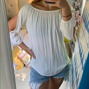 White blouse with sleeve cutouts